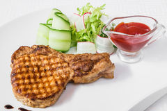 Delicious breakfast. Fried grilled steak, vegetable salad and sauce. Horizontal frame Stock Photos
