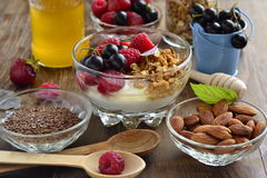 Delicious breakfast with granola, berries, yogurt and seeds. Royalty Free Stock Images