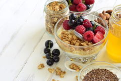 Delicious breakfast with granola, berries, yogurt and seeds Royalty Free Stock Photos