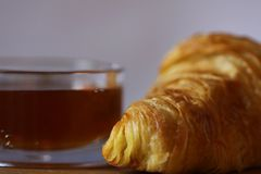 Delicious breakfast with honey and croissant royalty free stock image
