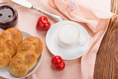 Delicious breakfast with a nice cup of coffee, fresh braided bre Royalty Free Stock Images