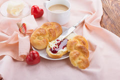 Delicious breakfast with a nice cup of coffee, fresh braided bre Royalty Free Stock Photos