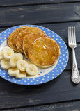 Delicious Breakfast pancake with honey and banana slices Stock Photos