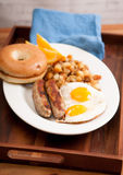 delicious breakfast sausage with sunny side up eggs Stock Photography