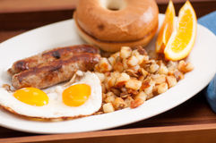 delicious breakfast sausage with sunny side up eggs Stock Photo