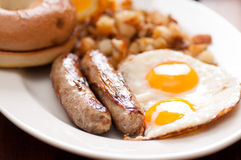 delicious breakfast sausage with sunny side up eggs Royalty Free Stock Photo