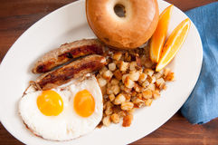 delicious breakfast sausage with sunny side up eggs Stock Images