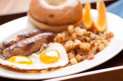 delicious breakfast sausage with sunny side up eggs Stock Photos
