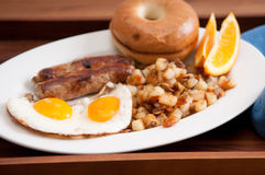 delicious breakfast sausage with sunny side up eggs Stock Image