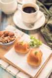 Delicious breakfast. Served with bread, Sausage Rolls black coffee and nut, on Wooden table. Top view. View from above. Selective royalty free stock image