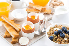 Delicious breakfast with soft boiled eggs and crispy toasts Stock Image