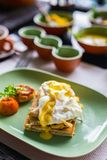Delicious breakfast. Breakfast table filled with assorted food.  Poached eggs, Sri lankan curry and tea Royalty Free Stock Images