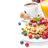 Delicious breakfast with waffles, berries, orange juice Stock Photography