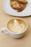 Delicious breakfast and white coffee. Drawings on coffee. Delicious breakfast Royalty Free Stock Images