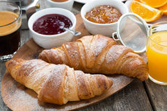 Delicious Breakfast With Fresh Croissants On Wooden Table Royalty Free Stock Photography