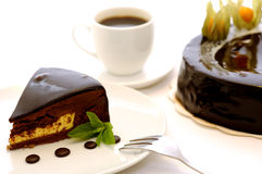 Delicious brown chocolate cake. Delicious French bakery. Chocolate cake with coffe and touch of mint stock photo