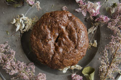 Delicious brownie decorated with pink flowers Stock Image