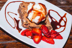 Delicious Brownie with ice cream and strawberry, delicious dessert Royalty Free Stock Photos