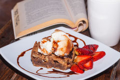 Brownie With Ice Cream Relaxing Reading Evening Royalty Free Stock Photo