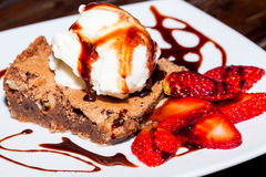 Delicious Brownie with ice cream and strawberry, delicious dessert Stock Photos
