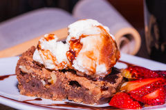 Delicious Brownie with ice cream and strawberry, delicious dessert Royalty Free Stock Image
