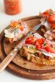 Delicious Bruchetta with ham and tomato Stock Image