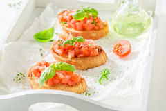 Delicious bruschetta with basil and tomato for a snack Royalty Free Stock Image