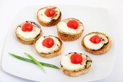 Delicious bruschetta (Italian Toasted Garlic Bread ) with zucchini, cherry tomato and mozzarella Stock Images