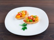 Delicious bruschetta with paprika and herbs Royalty Free Stock Photography