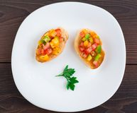 Delicious bruschetta with paprika and herbs Royalty Free Stock Photo