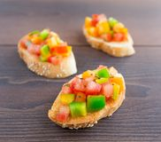 Delicious bruschetta with paprika and herbs Stock Photography