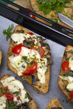 Delicious bruschetta with tomatoes, cheese and mushrooms Stock Images