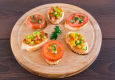 Delicious bruschetta with vegetables and herbs Stock Images