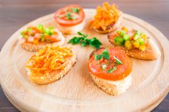 Delicious bruschetta with vegetables and herbs Royalty Free Stock Photo
