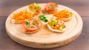 Delicious bruschetta with vegetables and herbs Stock Photos