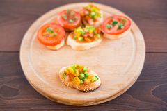 Delicious bruschetta with vegetables and herbs Royalty Free Stock Photography