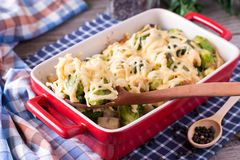 Delicious Brussels Sprouts Casserole with Grated Cheese and Spices. closeup on Wooden background stock photo