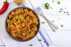 Delicious bulgur with vegetables, meat and greens on a white wooden table. Dietary menu. Proper nutrition. Top view stock images