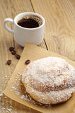 Delicious bun and cup of coffee Royalty Free Stock Photos