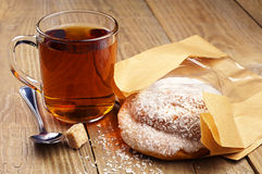 Delicious bun and cup of tea Stock Image