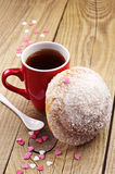 Delicious bun and cup of tea Royalty Free Stock Images