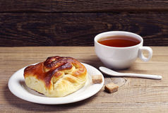 Delicious bun and tea Stock Images