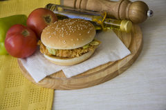 Delicious burger against fresh vegetables Royalty Free Stock Images