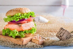 Delicious burger with fish and vegetables Stock Images