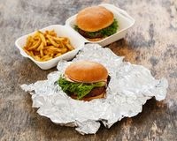 Delicious burger on the table Royalty Free Stock Photos