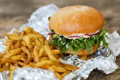 Delicious burger on the table Royalty Free Stock Photo