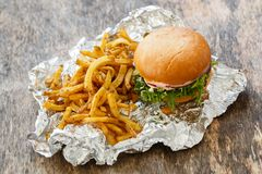 Delicious burger on the table Royalty Free Stock Photography