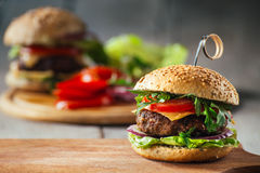 Delicious burgers with beef, tomato, cheese and lettuce Stock Photography
