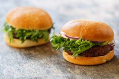 Delicious burgers on the table Royalty Free Stock Images