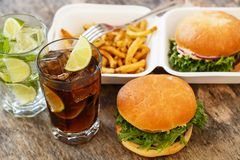 Delicious burgers on the table Royalty Free Stock Photo